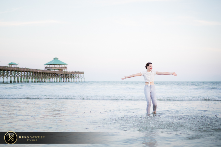high school senior portraits at folly beach sc by charleston senior portrait photographers king street studios