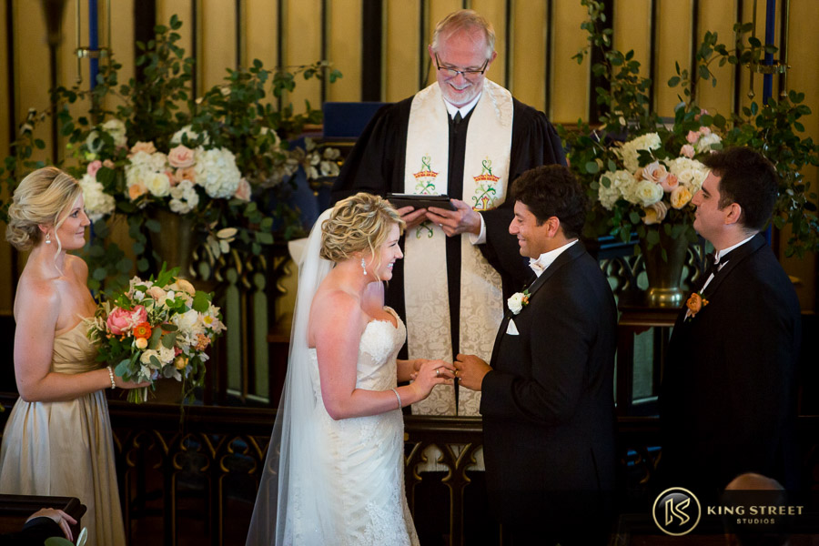 wedding pictures of bergen + philipe smiling together at their ceremony by charleston wedding photographers king street studios