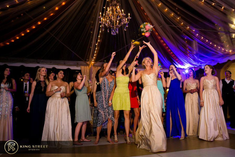 charleston wedding photography- bouquet toss at the william aiken house by charleston wedding photographers king street studios