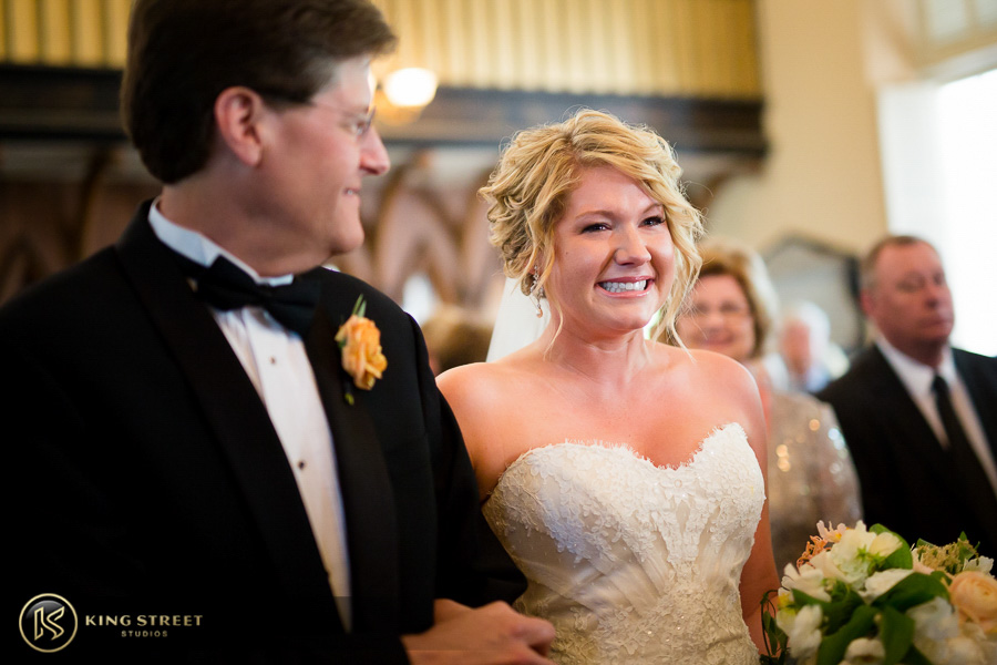 wedding pictures of bergen + philipe coming down the isle by charleston wedding photographers king street studios